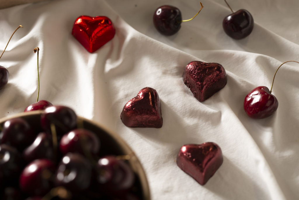 Heart shaped chocolates and cherries arranged to celebrate Valentine's